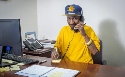 Baker Employee on telephone
