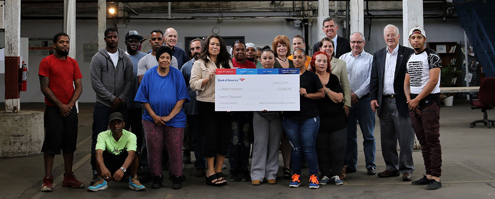 Baker industries receiving check from Bank of america