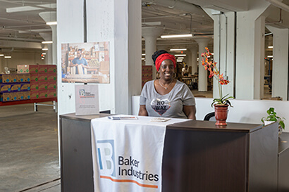 Baker Employee greets visitors at our warehouse