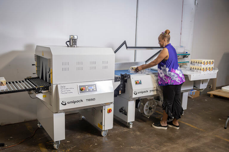 Baker Industries EMployee Operating Shrink Wrapping Machinery