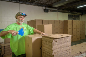 Baker Industries employee assembles boxes