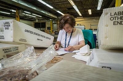 Baker Employees preparing mail and packages