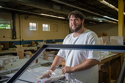 Baker Employees Shrink Wrapping